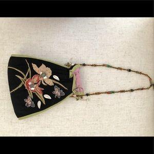 Embellished floral evening purse.
